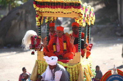His Divine Holiness Acharya Swamishree showers His divine blessings on all seated on the elephant