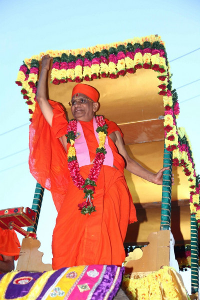 His Divine Holiness Acharya Swamishree prepares to dismount the elephant at the end of the grand street procession
