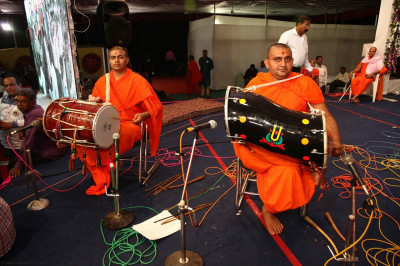 Sants perform dhol during the raas programme