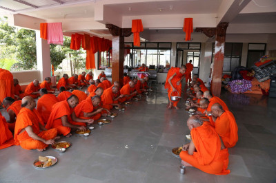 His Divine Holiness Acharya Swamishree and Sants dine on prasad lunch
