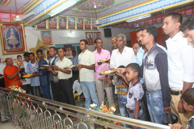 Disciple perform aarti to the Lord