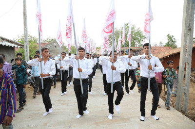 Disciples march to the sabha mandap