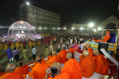 Acharya Swamishree Maharaj watches the raas
