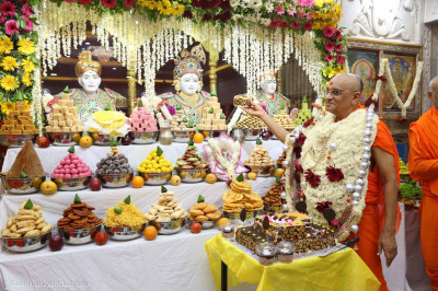 Prasad cake is offered to the Lord