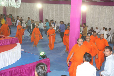 Sants and disciples take part in the raas
