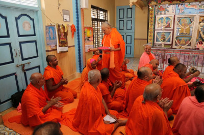 His Divine Holiness Acharya Swamishree lovingly applies gulal to all