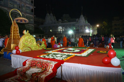 The golden chariot and grand stage decorated with fresh flower petals at Shree Swaminarayan Mandir Maninagar