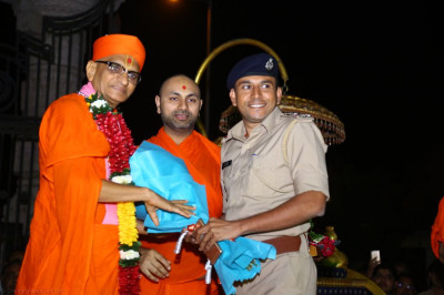 His Divine Holiness Acharya Swamishree blesses honoured guests