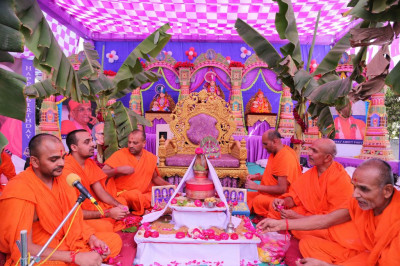 Sants perform the mass poojan ceremony