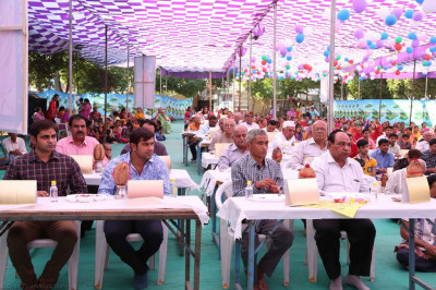 Hundreds of disciples take part in the mass poojan ceremony