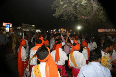 Disciples sing devotional songs and dance as the mini procession proceeds towards the evening concert ground