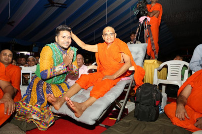 His Divine Holiness Acharya Swamishree blesses the dance choreographer after the devotional dance performance