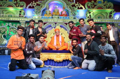 His Divine Holiness Acharya Swamishree blesses members of the dance choreography team