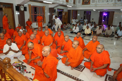 Sants and disciples gather inside the main mandir for the official grand opening early in the morning