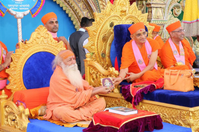 His Divine Holiness Acharya Swamishree presents the newly releases audio CD of devotional songs to the honoured guest
