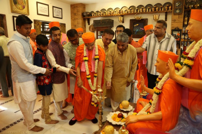 His Divine Holiness Acharya Swamishree and disciples light the flame of peace