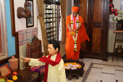 His Divine Holiness Acharya Swamishree showers flower petals on the scene