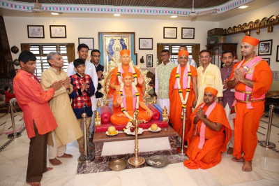 His Divine Holiness Acharya Swamishree blesses sants and disciples inside Shree Purushottam Pragatya Dham