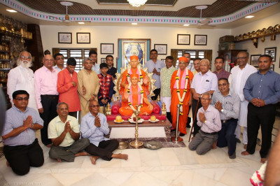 His Divine Holiness Acharya Swamishree blesses disciples inside Shree Purushottam Pragatya Dham