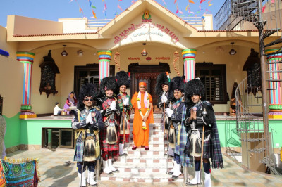 His Divine Holiness Acharya Swamishree blesses band majors of Shree Muktajeevan Swamibapa Pipe Band Nairobi, India, USA, London, and Bolton