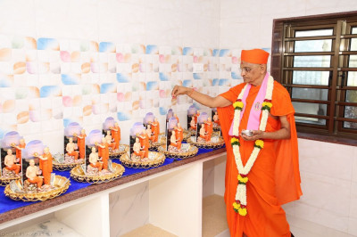 His Divine Holiness Acharya Swamishree consecrates the gifts to be offered to the Lord