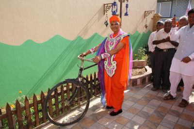 Divine darshan of His Divine Holiness Acharya Swamishree with a bicycle from the period of His childhood