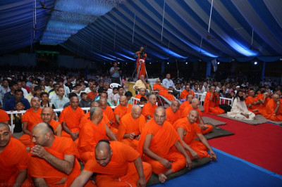 His Divine Holiness Acharya Swamishree, sants and thousands of disciples enjoy the evening programme