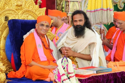 His Divine Holiness Acharya Swamishree blesses Akhilesh Swami from Hardvara