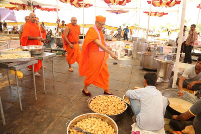 His Divine Holiness Acharya Swamishree consecrates various sweets and savoury items