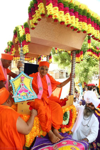 His Divine Holiness Acharya Swamishree mounts one of the four elephants