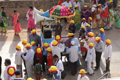 Disciples perform dances to devotional songs as the procession proceeds