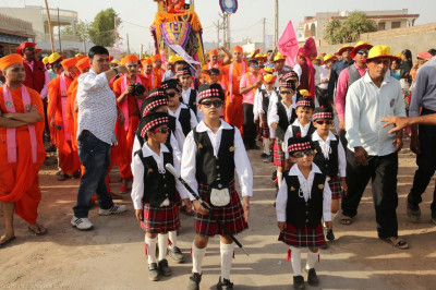 The cadets of Shree Muktajeevan Swamibapa Pipe Band march throughout the grand procession