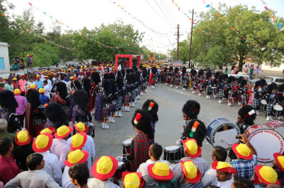 All five Shree Muktajeevan Swamibapa Pipe Bands perform forming a triangle at the start of the village of Bharasar