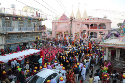 The entire procession arrives outside Shree Swaminarayan Mandir Bharasar in the Bharasar village square