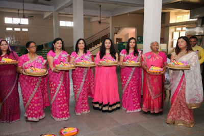 Disciples hold gifts for Lord Shree Swaminarayan