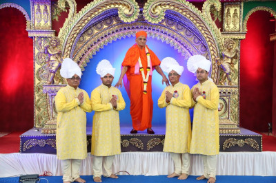 His Divine Holiness Acharya Swamishree blesses disciples who have sponsored the celebrations of the day on stage