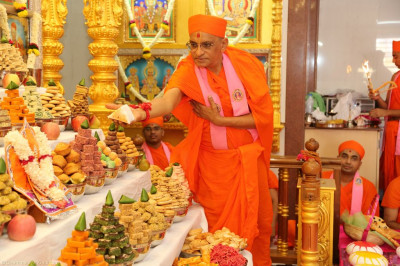 His Divine Holiness Acharya Swamishree offers delicious cake to Lord Shree Swaminarayanbapa Swamibapa and Shree Harikrishna Maharaj