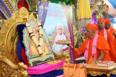 His Divine Holiness Acharya Swamishree offers penda (Indian sweets) to Jeevanpran Shree Abji Bapashree