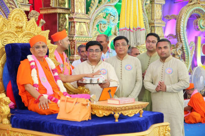 His Divine Holiness Acharya Swamishree consecrates prasad ice cream