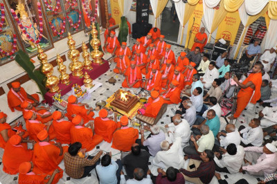 His Divine Holiness Acharya Swamishree performs the poojan ceremony for the new kalashs and flags as sants chant sacred sanskrit sloks