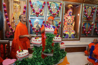 His Divine Holiness Acharya Swamishree lights the cake
