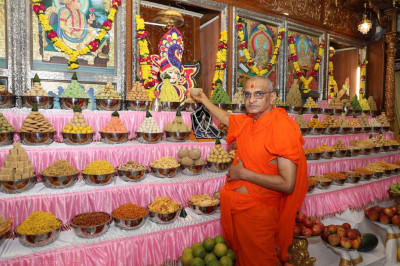 His Divine Holiness Acharya Swamishree offers sweet items to Lord Shree Swaminarayan