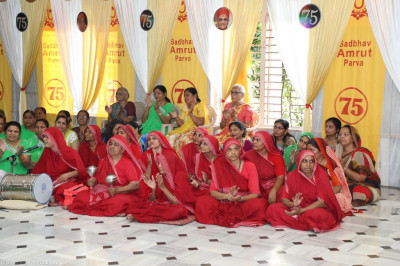 Sankhya Yogi ladies and disciples enjoy the devotional performances