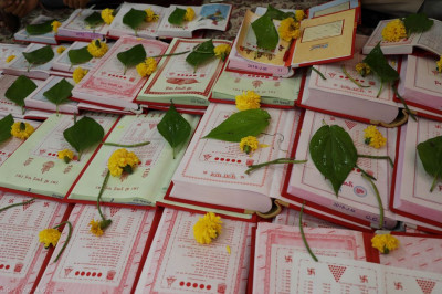 Disciples bring and arrange their financial account books for the past and coming year in preparation for chopra poojan