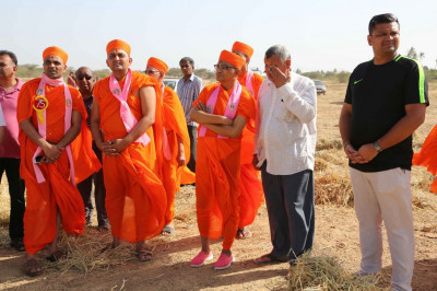 His Divine Holiness Acharya Swamishree, sants and disciples visit a disciple's field