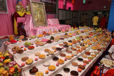 A variety of sweets and savouries in the form of annakut are offered to the Lord