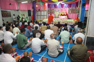 Disciples perform poojan as part of the 75th anniversary of His Divine Holiness Acharya Swamishree