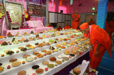 His Divine Holiness Acharya Swamishree blows out the candles on the cake