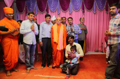 His Divine Holiness Acharya Swamishree blesses disciples who took part in the evening programme performances