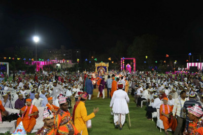 Thousands of disciples gather to enjoy the evening programme of devotion to the Lord
